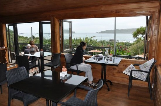 The Bay House Restaurant: View from inside looking out over the great surf break.