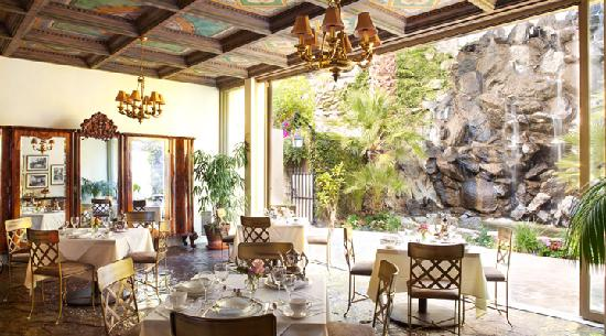 The Willows : A view of the formal dining room and the verandah by the waterfall.