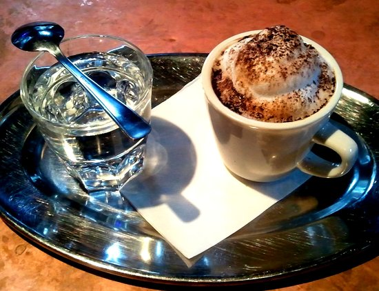 Subeez Cafe: A cappuccino, served traditionally with water.