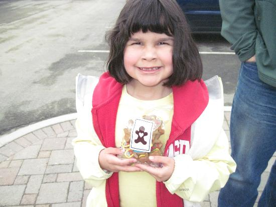 The girl with her bag of gingerbread cookies from the Gingerbread Factory