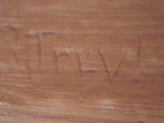 Red Rock Park: Example of someone's name carved in red rock formation