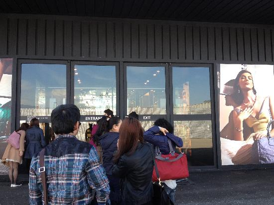 Prada Outlet (Space): small line of people waiting for the store to open