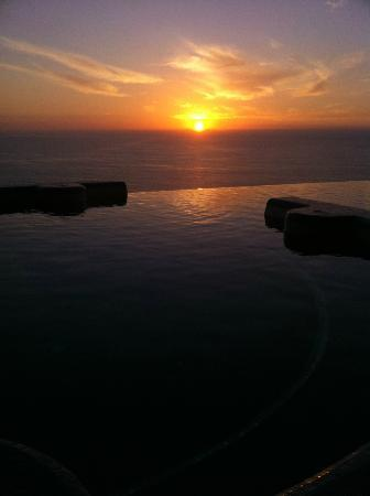 Grand Miramar All Luxury Suites & Residences: The sunset from behind the rooftop infinity pool cannot be beat!