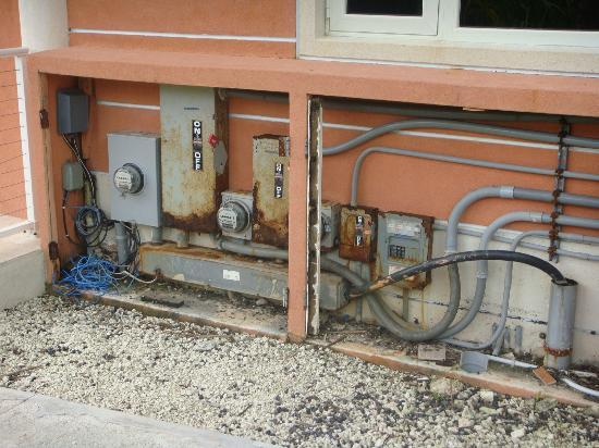 Oceania Properties: Rusted and unprotected electrical panel