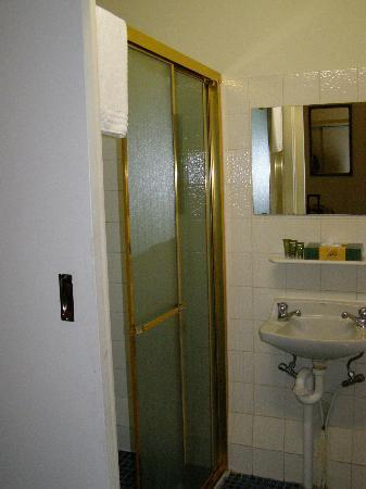 Small Bathroom With Shower Behind A Sliding Door Picture Of