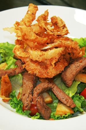 Christina's Bistro at Van Loveren: Our MAN-salad, with steak strips, potato wedges and onion rings
