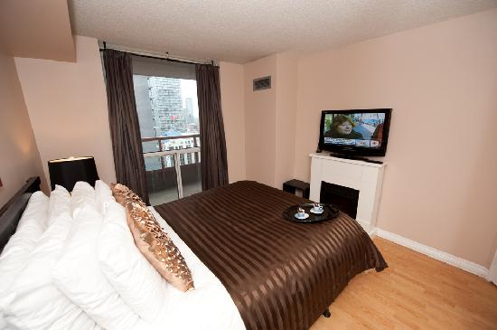 Canada Suites Toronto Furnished Rentals: 1 Bedroom Executive Suite - The Bedroom with walkout to a spacious terrace / balcony