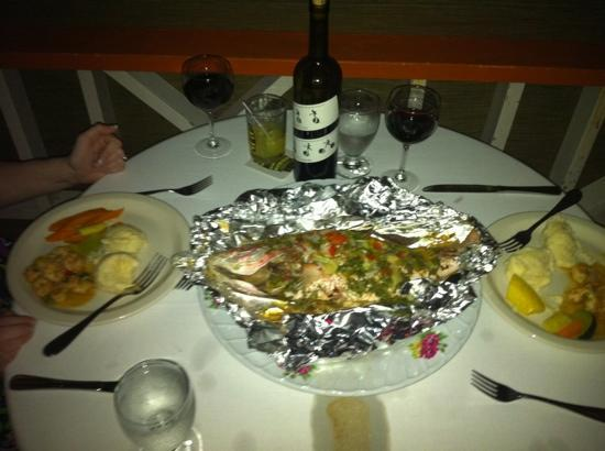 Coco Plum Island Resort: Our romantic dinner along with the fish we caught.