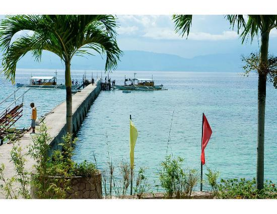 Kasai Village Dive & Spa Resort: Pier under construction - with two dive boats