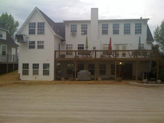 Bradford Inn: The back of the main building with dining inside and patio area