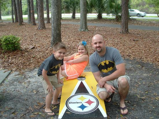 Nick's Steak and Seafood : After our meal, we were happy to pose for pics outside by the Steelers corn hole set!