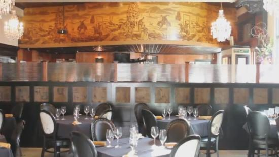 The Milias Restaurant: Cowboy mural over the horseshoe bar