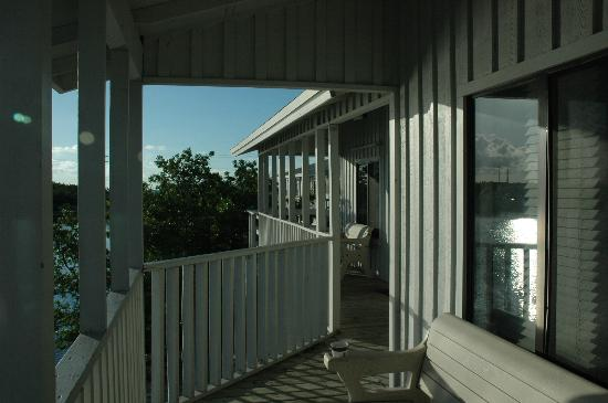 Bahia Honda State Park Campgrounds: Elevated walkway and deck connecting the cabins, facing the water