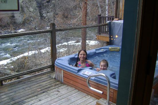 River's Edge Resort: hot tub on deck overlooking river(still snow on the ground)