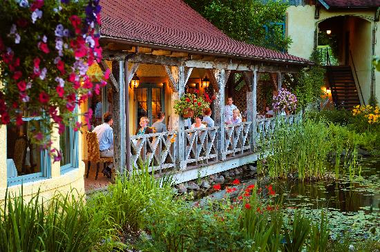 The Dining Room at Mirbeau Inn & Spa: Porch Dining available overlooking the Ponds & Gardnes