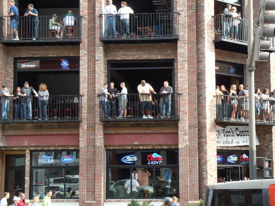 Downtown Nashville: Lots of people listening to live bands.