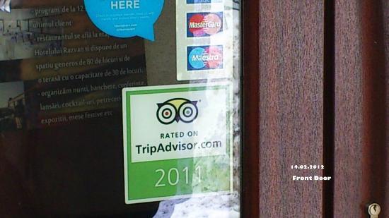 Hotel Razvan: Main Door - last year TripAdvisor sticker