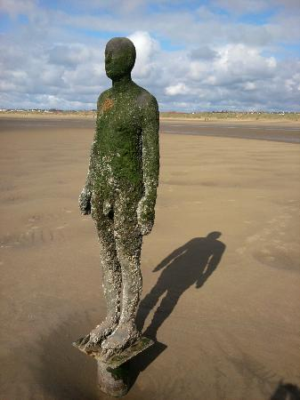 Antony Gormley's Another Place: Iron man closer to the sea... those barnacles look nasty