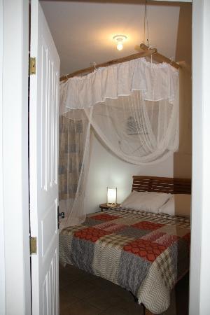 Recanto Rosa Amarela: Camera da letto matrimoniale con aria condizionata