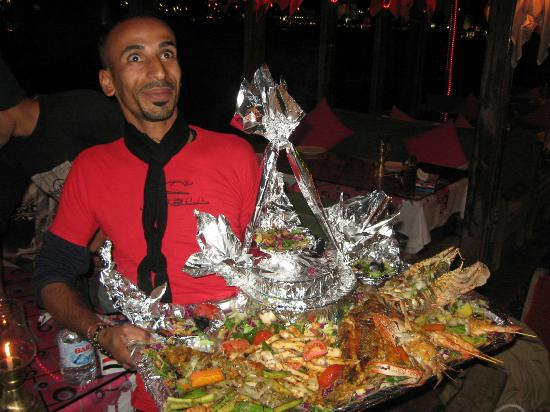 El Fanar: Waiter presenting our order