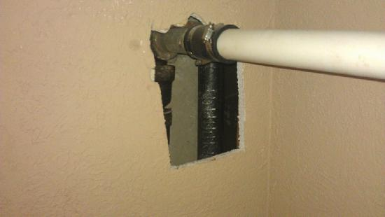 "Rodeway Inn Downtown near Riverwalk: 6"" hole in bathroom wall"