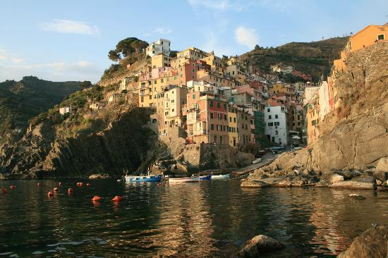 La Scogliera: Took this from the harbor and sunset, the apartment is in the center of this photo