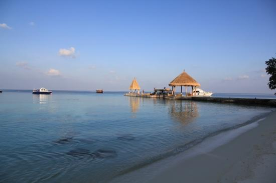 Jumeirah Vittaveli: arrival pier at the far end, BBQ restaurant at the beach