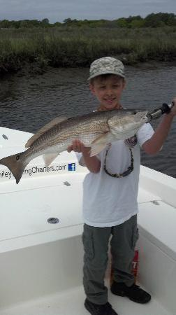 Captain Smiley Fishing Charters: My grandson's big red!