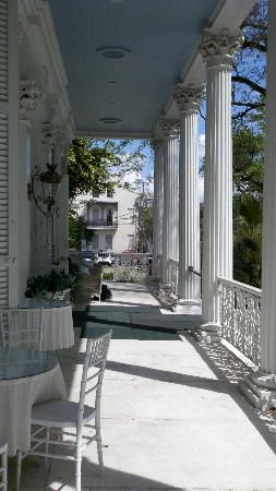 Magnolia Mansion: Spacious front porch with numerous chairs and tables for relaxing.