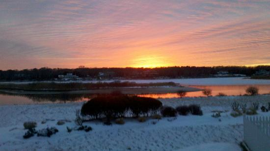 Seatuck Cove House Waterfront Inn: The Sunset from the back porch right after it snowed