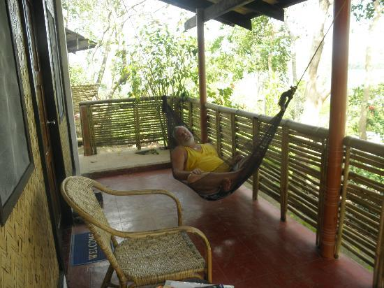 Discovery Island Resort and Dive Center : A wonderful Veranda area with Hammock!