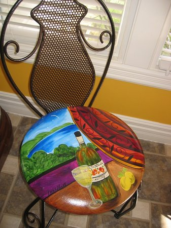 Globetrotters Bed and Breakfast: Dining chairs feature original art by Jane Hall.