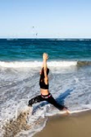Saving Grace Yoga and Massage Therapy: warrior in the waves