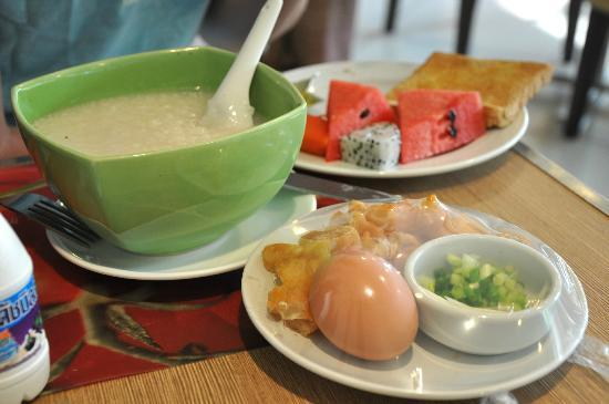 Bangkok Loft Inn: The pork congee, comes with the asian donut and dressings.