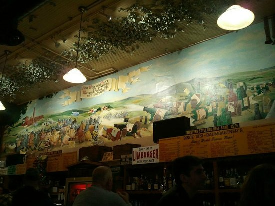 The battle between beer and wine mural over the bar at Baumgartner's!