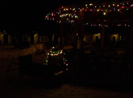 Gazebo with holiday lights on the grounds of the Adirondack Motel