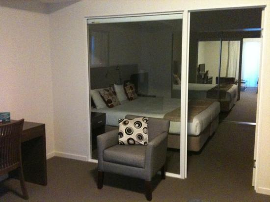 Quest Shepparton: Bedroom - view from living area - 1BR Apartment (separating window has blind you can pull down)