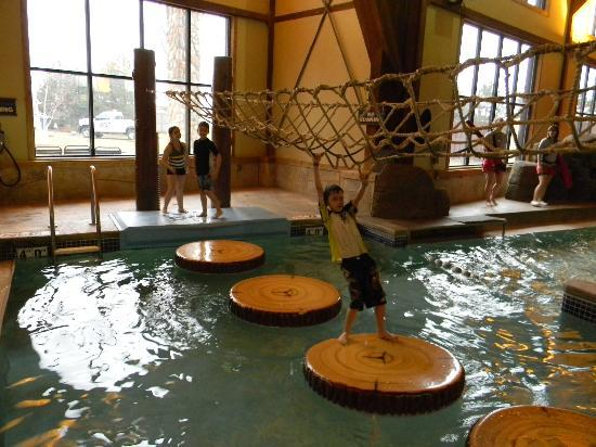 Great Wolf Lodge: jumping logs while holding onto rope