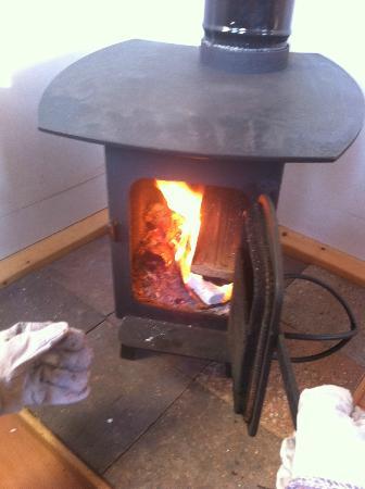 The Yurt Farm: wood burner in train carriage