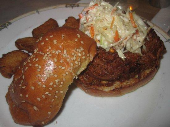 Village Whiskey: BBQ Pork Sammy: pulled pork shoulder, whiskey bbq, cole slaw, fried pickles