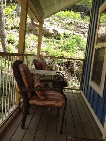 Allseasons Treehouse Village: covered upper deck of Treehouse #5. The cliff is beautiful!