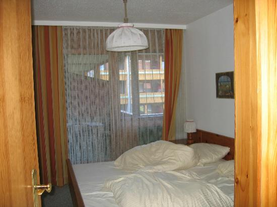 Chiemgau Appartements: Main bedroom with door onto balcony