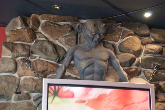 The devil watching over proceedings inside Hell Pizza