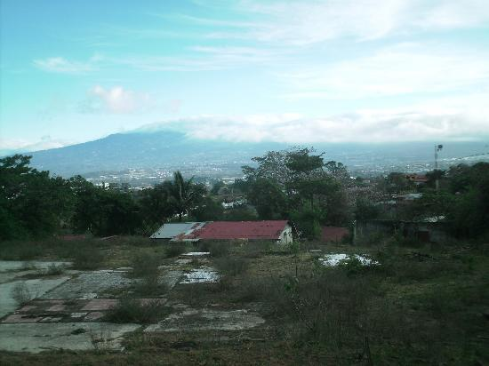 Villa Escazu: vacant lot at end of road looks out over san jose