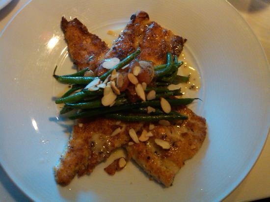 L'Albatros Brasserie + Bar: Roasted trout with tomato confit, haricots verts, and truffle butter. Delicious!