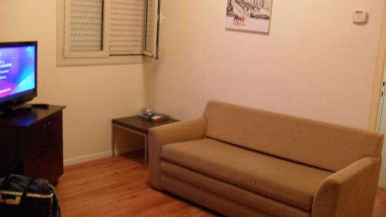 Ben Yehuda Apartments: living room, couch a bit stained, flat screen tv in l/r + bedroom