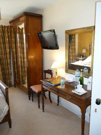 Cranbourne House: Wardrobe, TV and dressing table in room