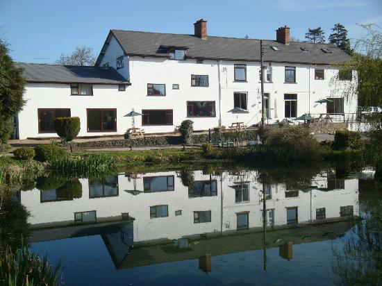 Three Wells Hotel: Three Wells from the pond. The original farmhouse is in the centre