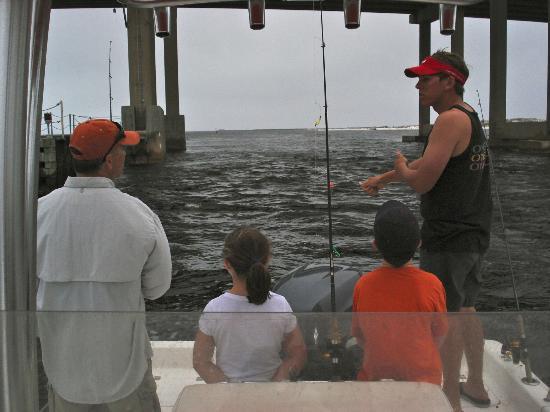 Fishing under the bridge from okaloosa island to destin for Destin florida fishing trips