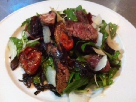 Essence Brasserie: pepper seared beef fillet with balsamic onions, slow roasted tomatoes, rocket & pecorino cheese
